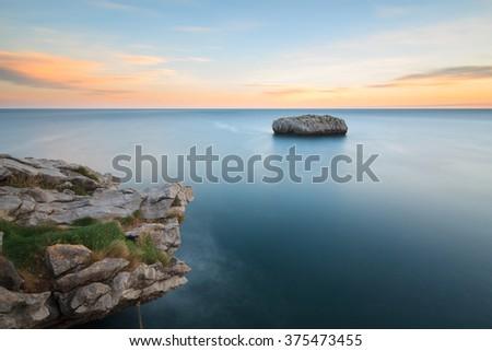 Cotonera island in Islares, Cantabria, Spain - stock photo