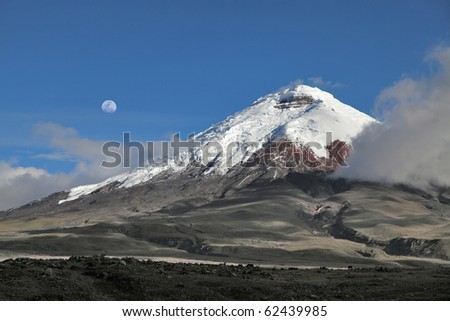 Cotopaxi volcano and moon - stock photo