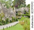 Cotswold village of Bibury and Arlington Row the prettiest row of houses in England - stock photo