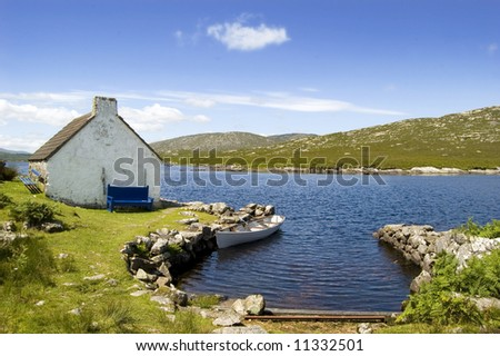 Cottage and boat in Connemara. Ireland - stock photo