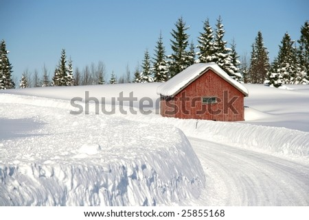 Cottage by a winter road