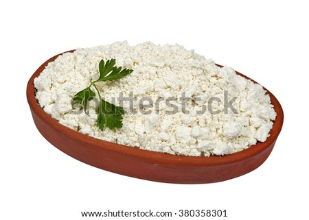 Cottage cheese in bowl on a white background - stock photo