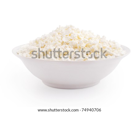Cottage cheese in plate isolated on white background - stock photo