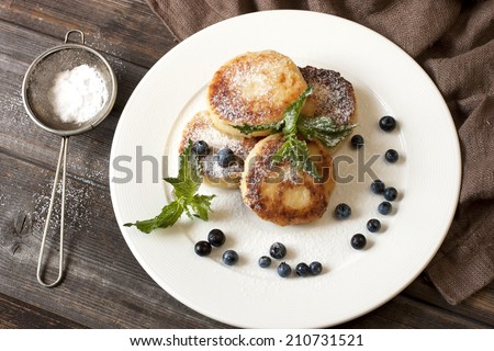 cottage cheese pancake with  mint leaves decoration - stock photo
