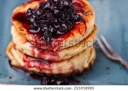 Cottage cheese pancakes with blueberry jam.selective focus - stock photo