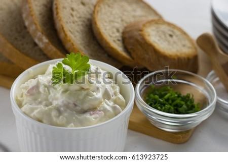 Cottage cheese spread in a bowl served and ready to eat with slices of bread