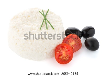 Cottage cheese with parsley leaf, olives and cherry tomato isolated on white background. - stock photo