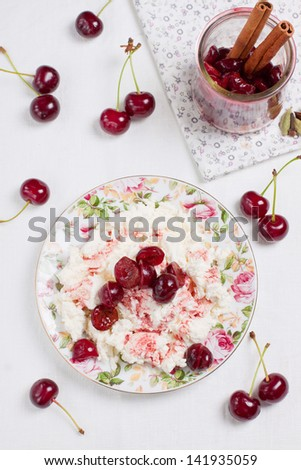 Cottage cheese with sour cherry compote and fresh cherries on background