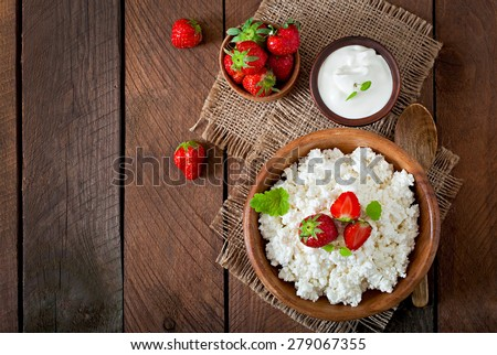 Cottage cheese with strawberries in a wooden bowl.  Top view - stock photo