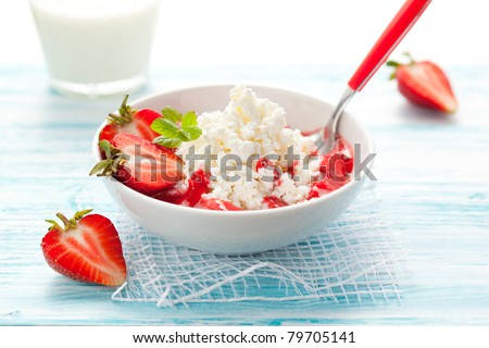 cottage cheese with strawberry sauce and fresh berries - stock photo