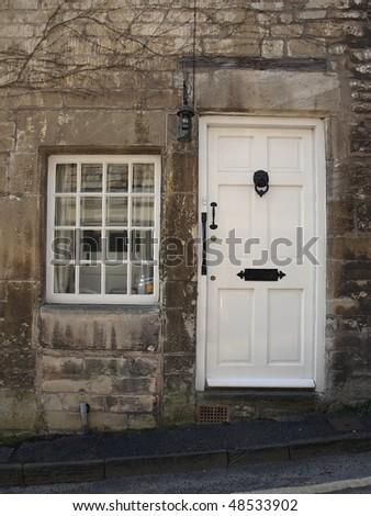 Cottage Doorway and Sash Window with Plenty of Copy Space - stock photo