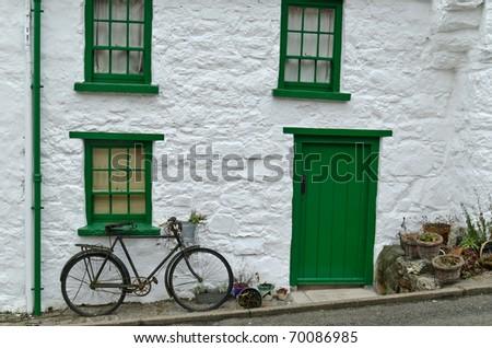 Cottage front image of dwelling in Glenoe village, county Antrim, Ireland - stock photo
