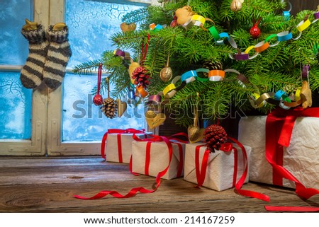 Cottage full of homemade Christmas decorations - stock photo