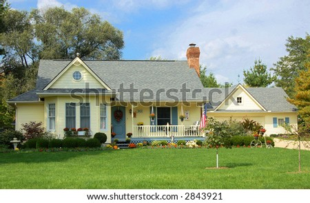 Cottage home in the country - stock photo