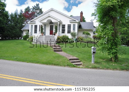 Cottage House suburban neighborhood mailbox street - stock photo