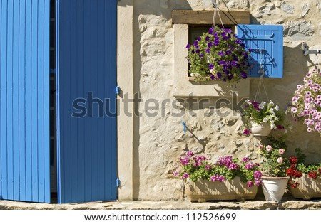 Cottage, house with blue door, shutter, flower. Provence. France.