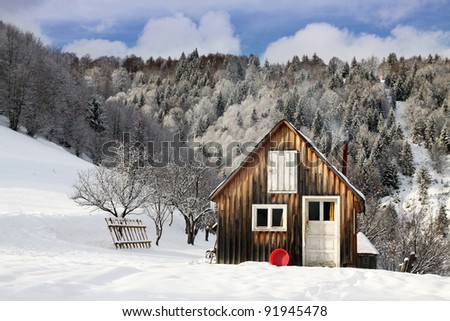 cottage in a beautiful snow forest. - stock photo