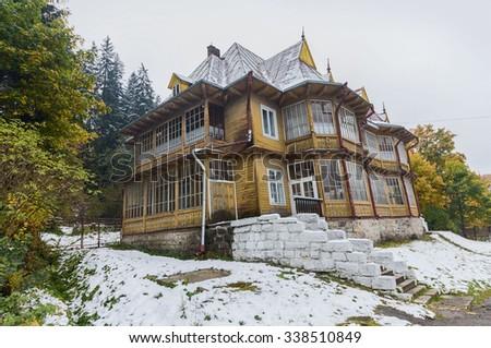Cottage in a classical style. Ukraine, Carpathians - stock photo