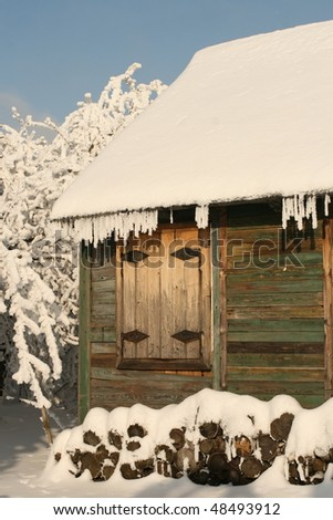 cottage in snow - stock photo