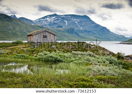 Cottage in the mountain in  norwegian nature. - stock photo