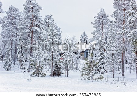 Cottage in the snow covered Ruka in Finland on the Arctic pole circle in winter