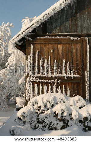 cottage in winter - stock photo