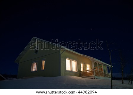 cottage in winter night