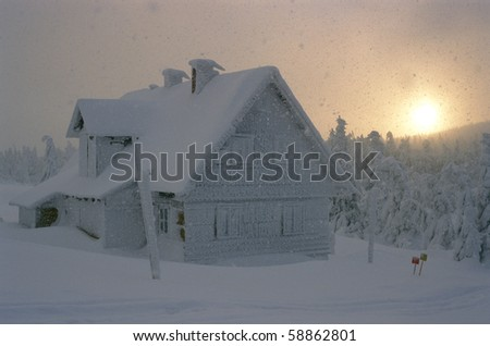 cottage in winter, Orlicke hory, Czech Republic - stock photo