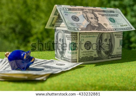 Cottage made of dollar banknotes, housing loan. Think green. Collect money for ecological house, - stock photo