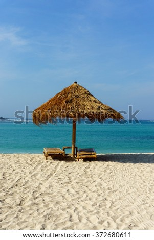 cottage  near lombok beach isolated with sea and blue sky. - stock photo