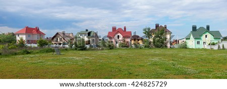 cottage on a green meadow - stock photo