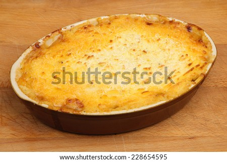 Cottage pie freshly baked in the oven - stock photo