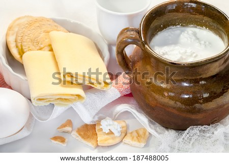 Cottage white cheese in a bowl , eggs  and pastry - healthy dietetic breakfast or snack. - stock photo