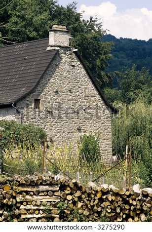 cottage with pile of logs in front the auvergne cantal massif central france europe