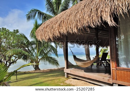 Cottage with Seaview on Tropical Beach - stock photo