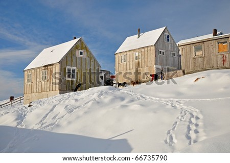 Cottages in the Kulusuk village, Greenland - stock photo