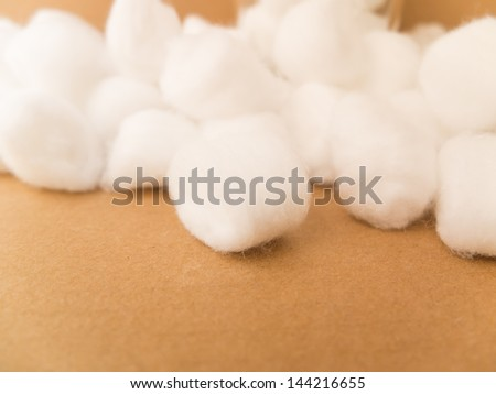 Cotton bales on brown paper background - stock photo