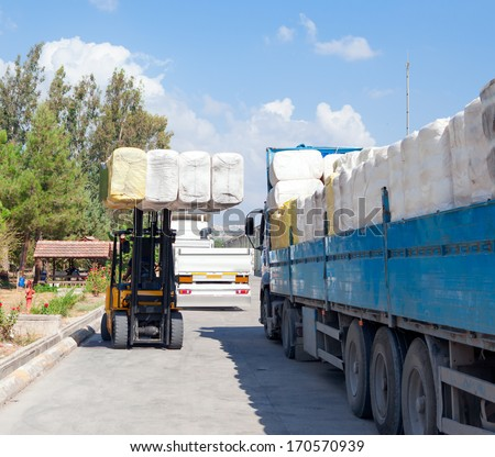 cotton bales, ready for delivery to cotton buyers.  - stock photo