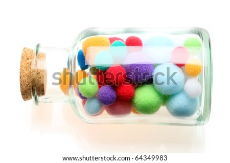 Cotton balls in a bottle - stock photo