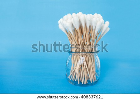 cotton bud in jar swab clean health care on blue background - stock photo