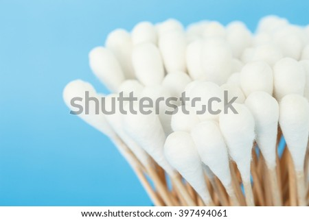 cotton bud, swab clean health care on blue background - stock photo