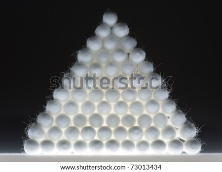 Cotton buds in triangle