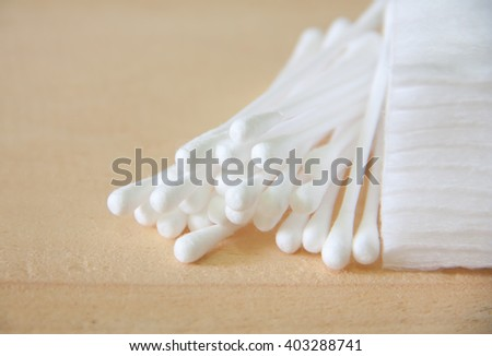 Cotton buds with Cotton on wood table. - stock photo