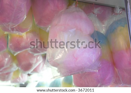 Cotton candy hanging in a concession stand. - stock photo