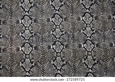 Cotton fabric with Snakeskin pattern for background or texture - stock photo