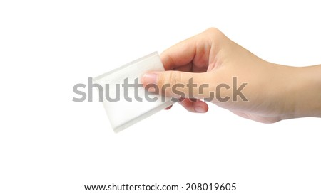 Cotton pad (rectangular shape) and hand on white background