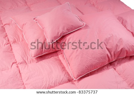 Cotton pink fluffy three pillows and duvet without cover, eiderdown filled with fluff or feathers. Horizontal orientation, nobody.