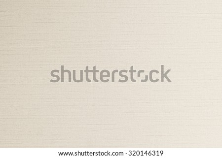 Cotton silk blended fabric wallpaper texture pattern background in light pale cream sepia beige color tone: Fine woven linen textile textured detail patterned backdrop in yellow creme toned colour   - stock photo
