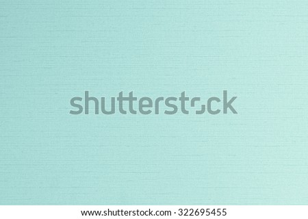 Cotton silk blended fabric wallpaper texture pattern background in light pale pastel green color tone: Fine silk linen organic natural textile textured detail patterned backdrop in blue toned colour  - stock photo