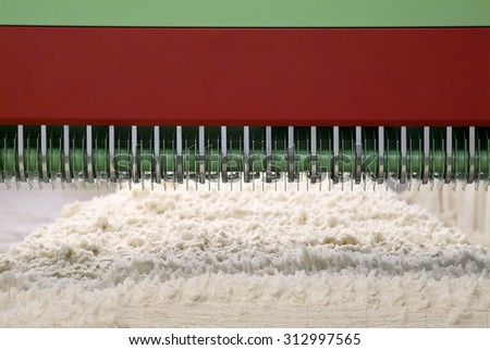Cotton Spinning Machine. Detail of Carding area - stock photo